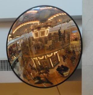 convex mirror reflection fo two-story carousel
