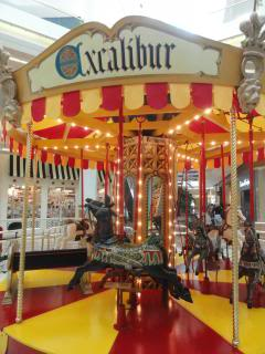 small indoor carousel called 'Excalibur'