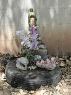 shrine to Mary, based on an old tire