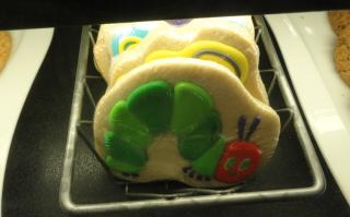 cookies with book art, Hungry Hungry Caterpillar on top