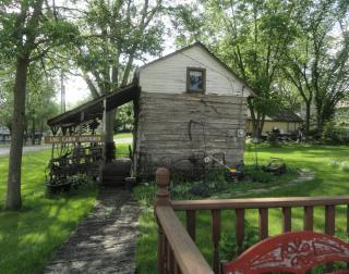 very old wooden cabin with porch