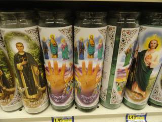 Catholic religious candles on a grocery-store shelf