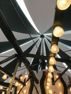lights and roof of a carousel from inside