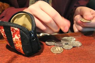 coins, coin purse, hands