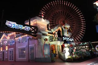 shopping neighborhood or fair, with giant wheel, Japan