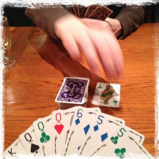 people playing Five Crowns, a card game