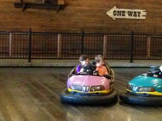 two kids sharing a bumper car