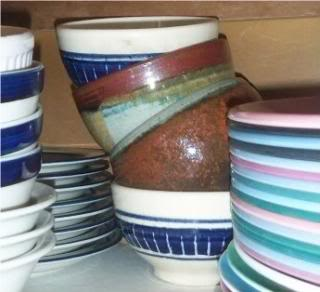 rice bowls, plates, in the cupboard